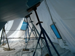 Photo: Looking forward along starboard inside tent prior removing paint.