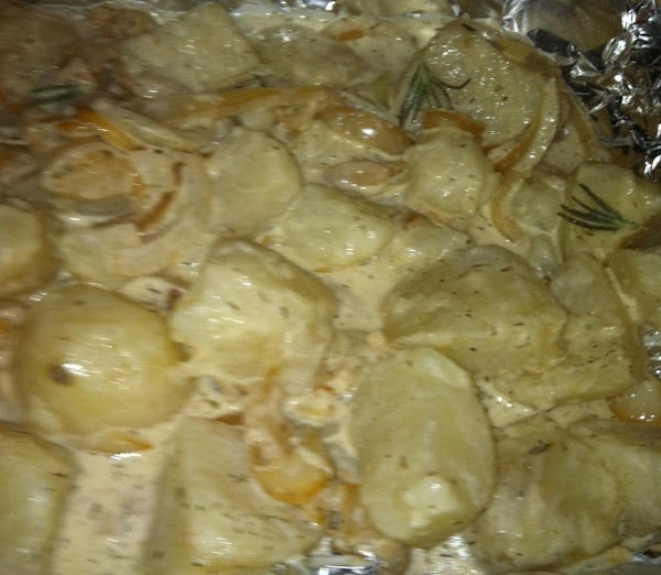 Add the herbs and Garlic  salt and pepper to potatoes. Toss gently. Pour...
