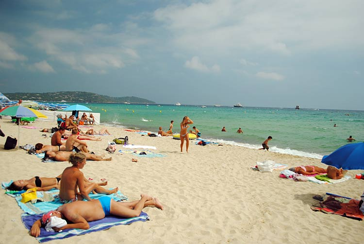 The beach scene at St. Tropez: Go for the azure waters, not for reasonably priced drinks.