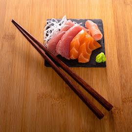 Sushi on slate on bamboo with chopsticks by Burdell Edwin - Food & Drink Plated Food ( tuna, wasabi, lunch, japan, restaurant, chopsticks, salmon, asian, dinner, delicious, bamboo, chinese, japanese, china, ginger, sushimi, pickled ginger, sushi, sashimi, wood, delicacy, slate )