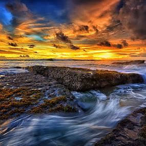 Lima Beach Sunset by Hendri Suhandi - Landscapes Waterscapes ( clouds, waterscape, sunset, lima beach, seascape, beach, stones, rocks )