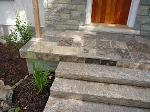 Photo: Facing over the concrete porch blends it into the landscape.