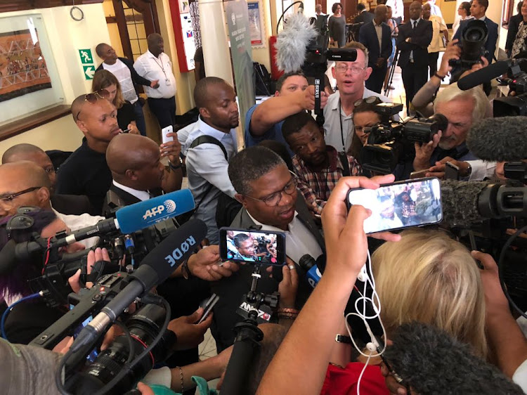 Police Minister Fikile Mbalula talks to reporters after the ANC parliamentary caucus meeting on 14 February 2018.
