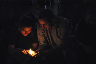 Photo: Sharing candle light...