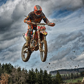 Trough The Clump Rain by Marco Bertamé - Sports & Fitness Motorsports ( clouds, orange, 580, speed, number, race, noise, jump, flying, red, motocross, clumps, air, high )