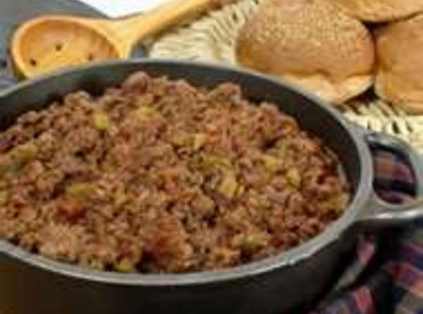 In a large fry pan (skillet) Brown ground beef green peppers, celery, & onion. Drain...