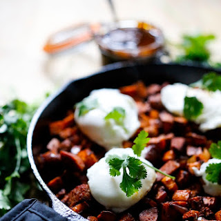 Harissa Sweet Potato Hash with Poached Eggs and Merguez Sausage.