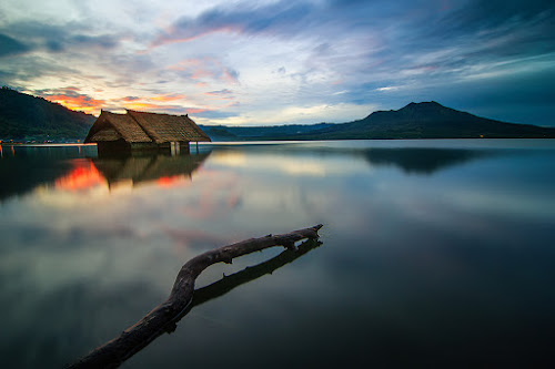 A Floating Hut at Dusk by Kadek Jaya - Landscapes Waterscapes ( mountain, hut, sunset, traditional, lake, architecture, classic )