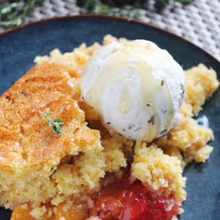 PEACH COBBLER WITH HONEY-THYME BISCUITS.