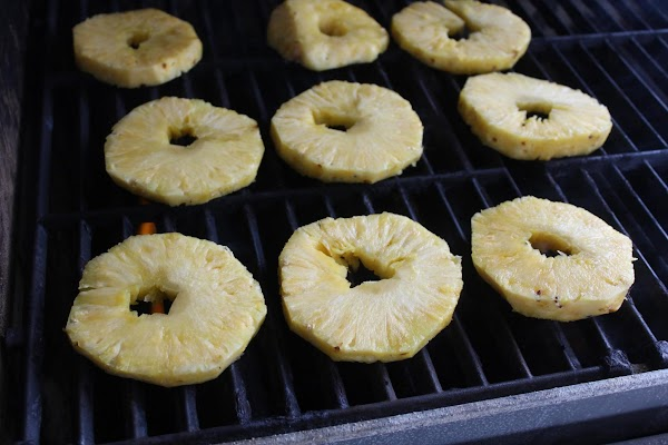 "On a preheated ""hot"" grill lightly oil the grill. Place pineapple slices on the..."