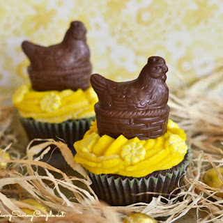 Chocolate Easter Hen Cupcakes with Yellow Butter Cream Frosting.