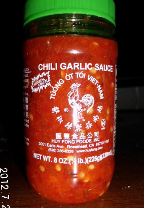 Spray one side of bread with spray oil, spread Thai chili sauce on other...