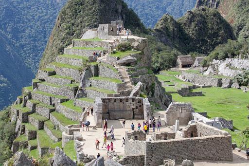 Visitors explore one of the ruins at Machu Picchu, Peru.