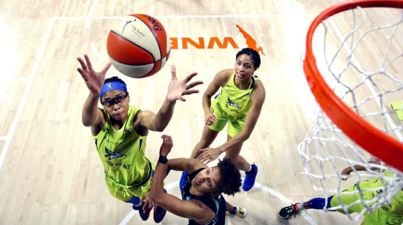 The Dallas Wings WNBA team playing basketball.