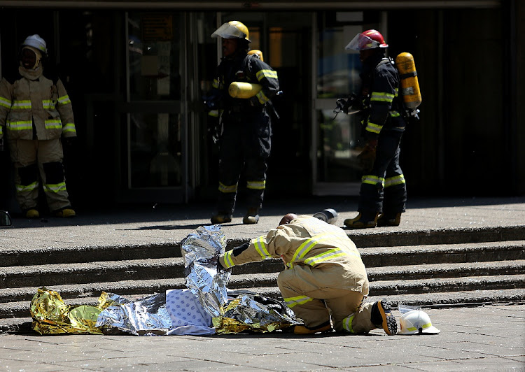 A firefighter fell to his death while battling a blaze on the upper floors of a government building in the Johannesburg CBD on Wednesday morning, September 5, 2018. The city's department of public safety's Twitter account confirmed the death. Picture: ALON SKUY