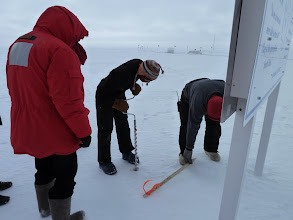 Photo: Katie drills for the new marker, Martin moving the place marker.