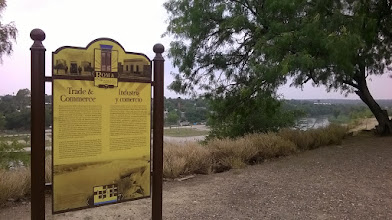 Photo: Roma bluffs - sign re trade and commerce
