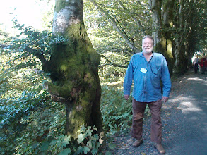 Photo: Jim next to a tree that looks like a troll.