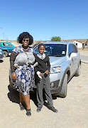 Top  actress Andrea Dondolo happily poses with  Kamvelihle Pinini of Dongwe, in the Eastern Cape.