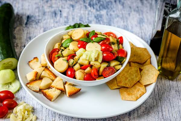 Chopped Caprese Salad With Crackers And Toasted Bread.