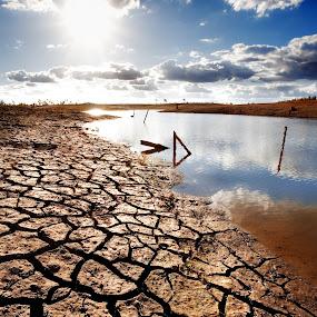 Drought by Ben Heys - Landscapes Deserts ( stream, australian, land, landscape, sun, drought, sky, mud, nature, wetland, creek, dirty, bush, wet, dirt, water, dry, bed, crack, damn, horizon, outback, lake, season, blue, australia, cloud, brown, earth, natural )