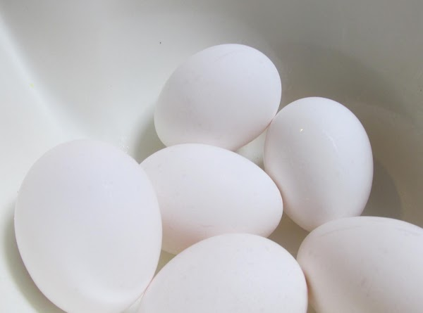 Now crack eggs into a medium size bowl, and add one at a time...