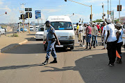 Mamelodi  taxi drivers stop working taxis  and off-load passengers. /   Veli Nhlapo