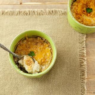 Baked Garlic Cauliflower Mash with Cheese Crust