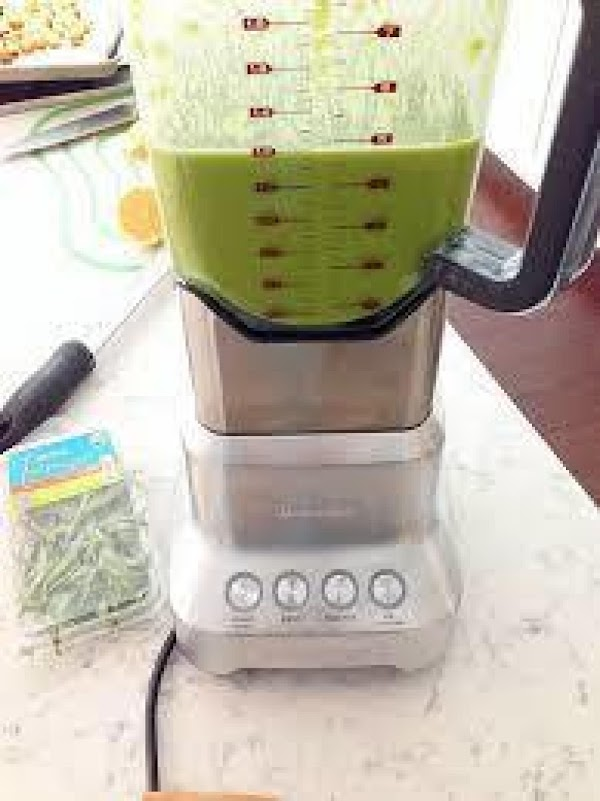 Using a blender, puree the soup in batches until smooth, add ham hocks back...