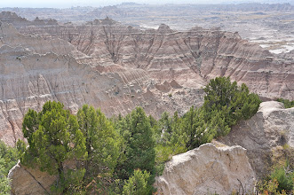 Photo: Erosion of the Badlands reveals sedimentary layers of different colors: purple and yellow (shale), tan and gray (sand and gravel), red and orange (iron oxides) and white (volcanic ash).