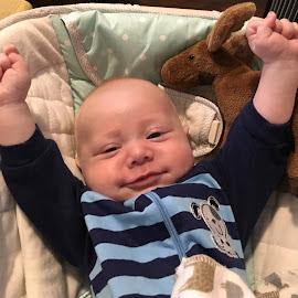 Baby In Blue by Sandy Stevens Krassinger - Babies & Children Babies ( stripes, smiling, baby, stretching, boy )