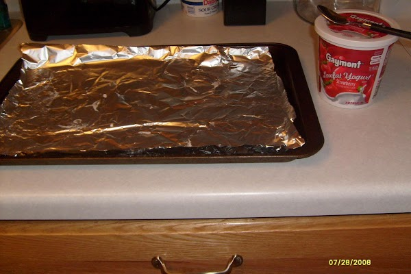 open yogurt container, stir, line cookie sheet with the tin foil or waxed paper.