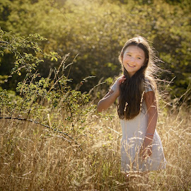 Meadow girl by Jiri Cetkovsky - Babies & Children Child Portraits ( gold, autumn, girl, portrait, sun, meadow )