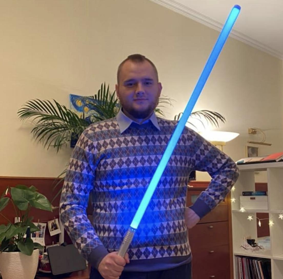 Denis Stelmak wielding a blue lightsaber