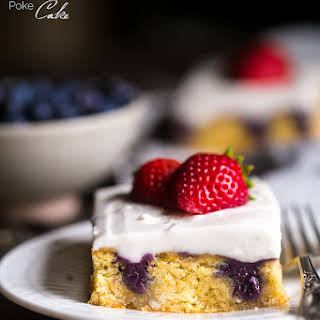 Paleo Poke cake with Blueberries, Strawberries and Coconut Cream.