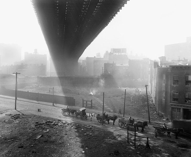 Photo: Shadows are cast beneath the Brooklyn Bridge, seen from a stable roof, on May 6, 1918. (Eugene de Salignac/Courtesy NYC Municipal Archives)