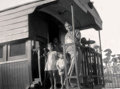 A family enjoys the ride in a railway saloon car