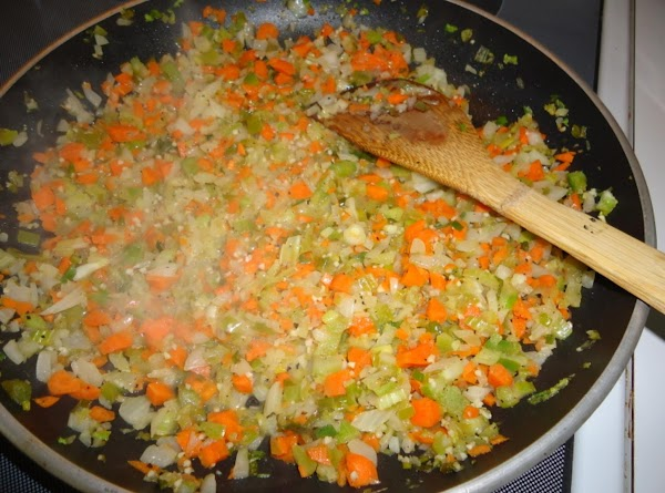 Melt butter in a skillet, cook all veggies until soft. Remove to a bowl...