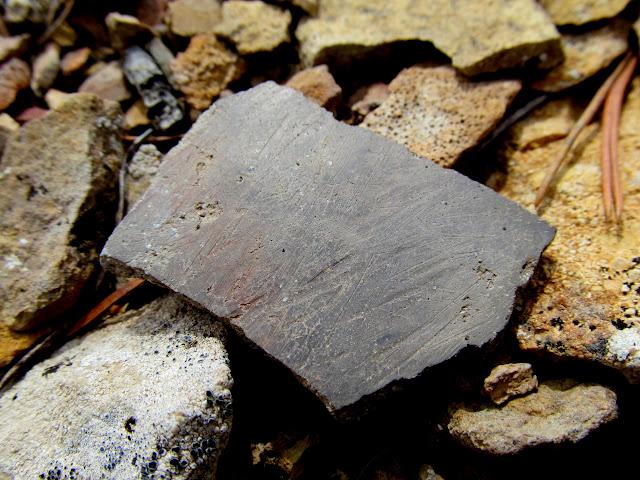 Texture on a plain gray potsherd