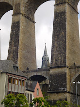 Photo: The railroad viaduct, built in 1861-1863, towers over the Flamboyant Gothic spire of the St-Melaine Church.
