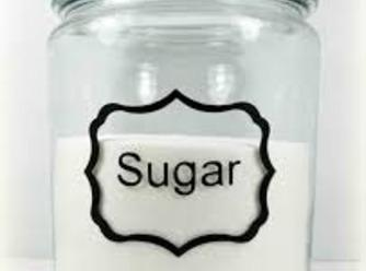 Once boiling, add in your 7 cups of sugar.  Whisk again and bring...