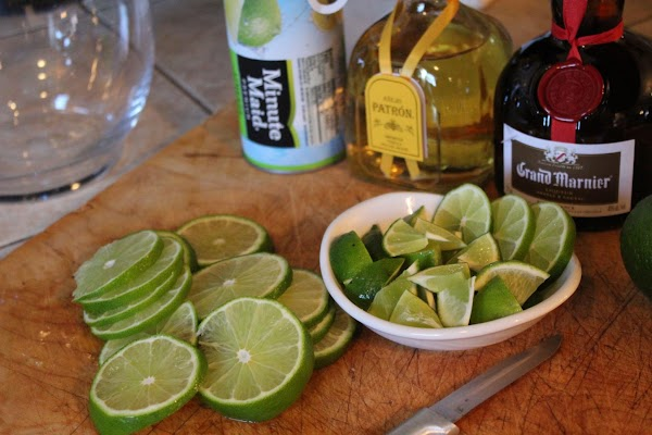 Thin slice one lime into circles and put in a glass pitcher.  Cut...