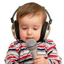 Photo: A thoughtful toddler with headphones and microphone is given a speech; closeup; isolated on the white background