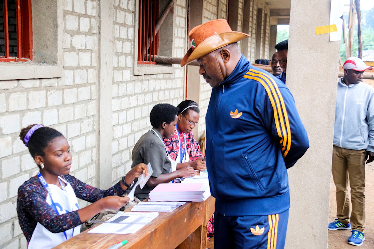 Burundi President Pierre Nkurunziza is registered by an electoral official before casting his ballot at a polling centre during the constitutional amendment referendum at School Ecofo de Buye in Mwumba commune in Ngozi province, northern Burundi, May 17, 2018.