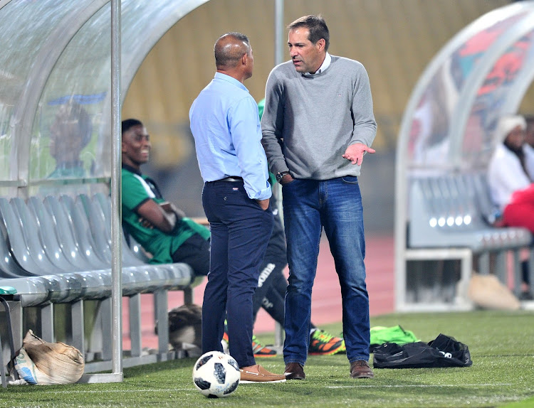 AmaZulu head coach Cavin Johnson chats with his Platinum Stars counterpart Roger De Sa following an Absa Premeirship match at Royal Bafokeng Stadium in Rustenburg on April 25 2018.