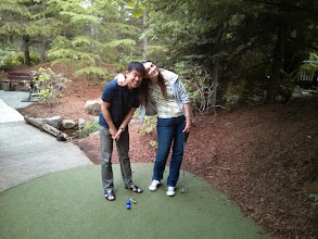 Photo: When trying to devise a strategy to tackle a mini-golf course, two heads are better than one!