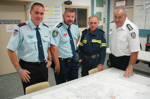 Narrabri Fire and Rescue Station Commander Shane Bradford, police Inspector Robert Dunn, RFS fire investigator Noel Scales and RFS Namoi Gwydir district commander operations Scott Mack, seen here with a map of Sunday's Boggabri fire, take a very dim view of those who deliberately light fires, especially in the current conditions.