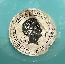 Photo: galliano ferro label, label reads  FORNASA DE MVRAN A L 'INSECNA DEL MORETO - MADE IN ITALY   'INSEGNA DEL MORETO' translates as 'Trade Mark of the Black-Haired'