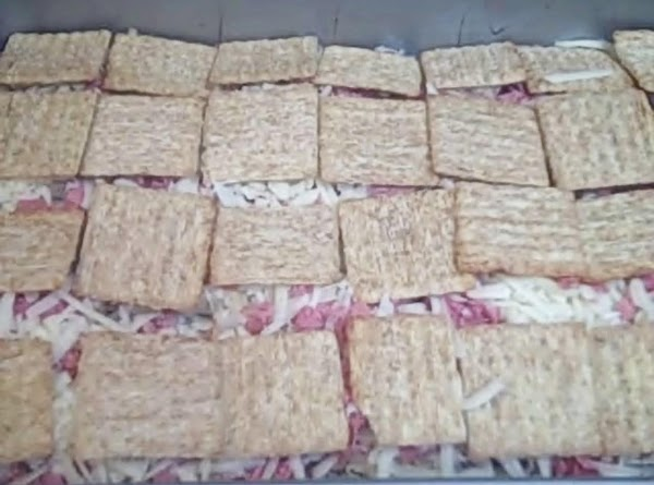 arrange 28 crackers in rows in a greased 13 x 9 pan Cover with layers...
