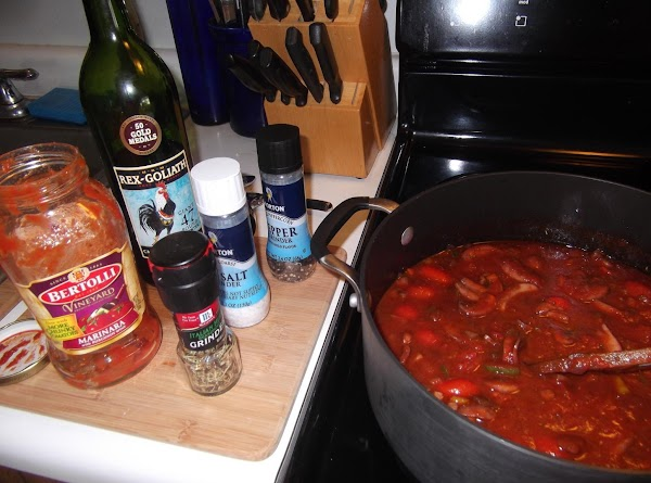 Add wine to cover veggies, about 3/4 cup.  Bring to boil, cook 5...